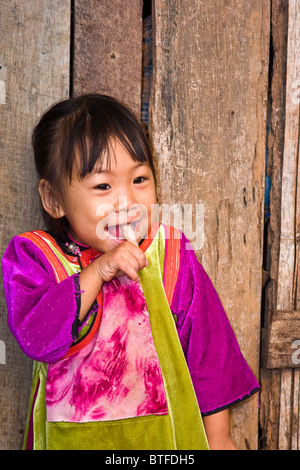 Little girl, about 3, in Lisu Village, Chiang Mai area of Northern Thailand. - Stock Photo