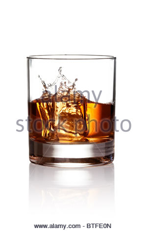 Whiskey splash. Isolated on white background, with clipping path - Stock Photo