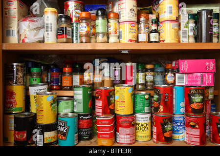 over stocked food cupboard - Stock Photo