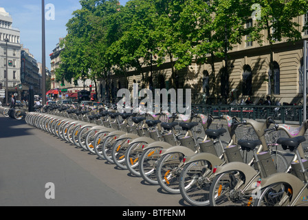 Row of Velib rental bicycles on a street in Paris - Stock Photo