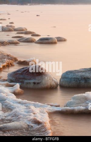 Stones in sea, winter time - Stock Photo