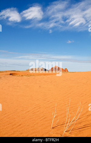 Sand dunes in the San Rafael Desert near Goblin Valley State Park in Utah USA. Gilson Buttes appear in the distant - Stock Photo