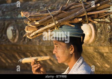 Burmese woman smoking a traditional cigar, Bagan (Pagan), Myanmar (Burma) - Stock Photo