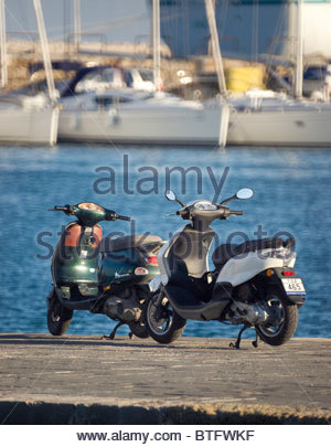 Mopeds at the seaside Greece - Stock Photo