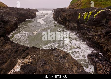 CAPE PERPETUA, OREGON, USA - Devils Churn, a chasm on the central Oregon coast. - Stock Photo