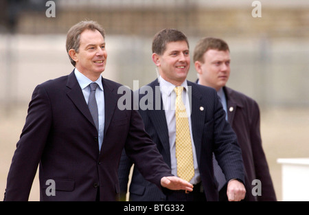 Prime Minister Tony Blair accompanied by two bodyguards on Horse Guards Parade to greet the President of the Italian - Stock Photo