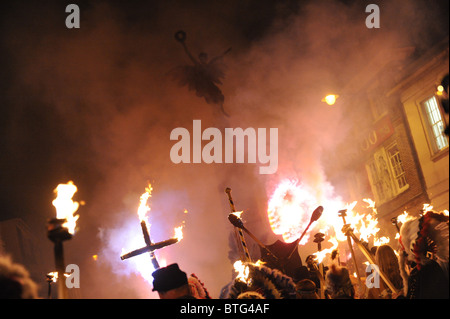 Lewes bonfire night celebrations Red Indians hold a burning crosses at the town's war memorial - Stock Photo