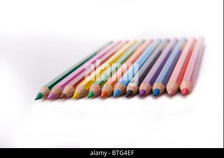 horizontal row of twelve colored pencils - Stock Photo