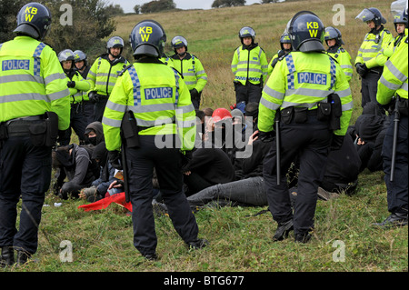 Police officers in riot gear kettle in protesters during a recent Smash EDO march held in Brighton Stock Photo