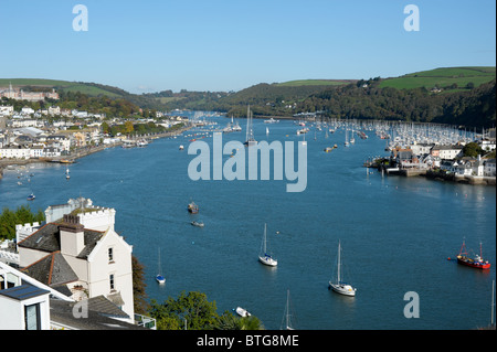 View from above looking up the River Dart dotted with sailing boats with clear blue skies and the Royal Naval College - Stock Photo