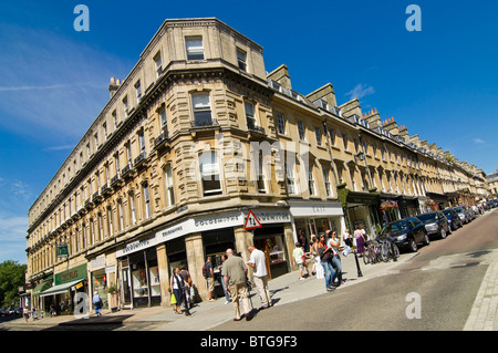 Horizontal wide angle view of classic Bathstone architecture in Bath city centre on a bright summer day. - Stock Photo