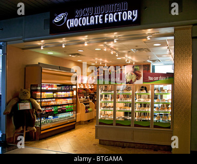 Rocky Mountain Chocolate Factory shop at Chicago O'Hare Airport, Illinois, USA - Stock Photo