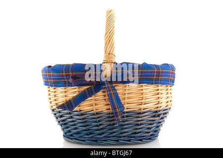Cheerful cane basket with checkered ribbon in blue - Stock Photo