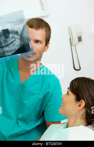 Patient with dentist holding dental panoramic xray - Stock Photo