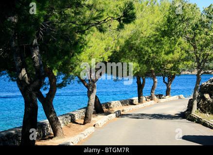 Promenade in Valun village on Cres Island, Croatia - Stock Photo