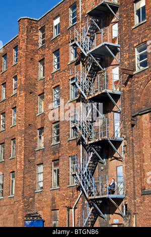 Fire escape tea break, Oxford Mills, adjacent to Ashton Canal, Ashton under Lyne, Tameside, Greater Manchester, - Stock Photo