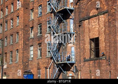 Fire escape tea break, Oxford Mills, adjacent to Ashton Canal, Ashton under Lyne, Tameside, Greater Manchester, - Stock Photo