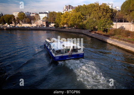 Bateau-mouche boat navigating on the Seine river, Paris, capital of France - Stock Photo