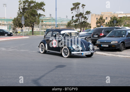 A Volkswagen Beetle takes part in the practice session for the Valletta Grand Prix for classic cars. - Stock Photo