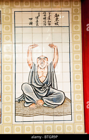 Painted tile panel in the Chinese Temple in Bandar Seri Begawan of an old man stretching and yawning. - Stock Photo