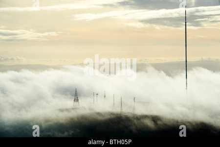 Early morning low cloud around Winter Hill Radio and TV Masts, North West England - Stock Photo