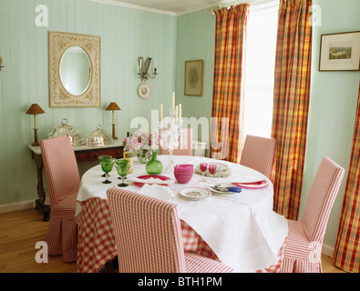 Dining Room Red Checked Loose Covers On Chairs At Table With White Linen Cloth In Pale Green