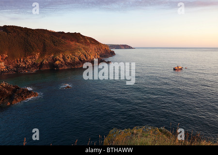 An RNLI lifeboat moored off the South West Coastal Path, near Cadgwith, The Lizard, Cornwall. - Stock Photo