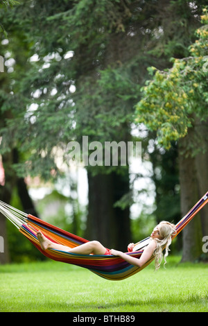 young woman relaxing on hammock - Stock Photo