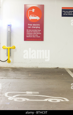 An electric vehicle charging station provided free of charge for customers at Camden Sainsbury's supermarket in - Stock Photo