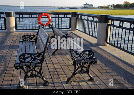 Two empty benches on the pier in Charleston, SC, USA - Stock Photo