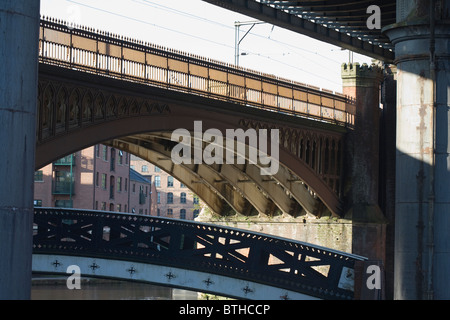 Iron footbridge and railway viaducts above Castlefield Canal Basin Manchester England