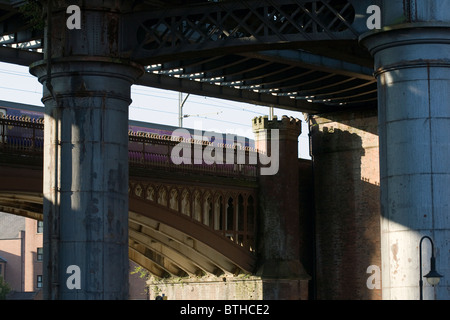 Iron footbridge and railway viaducts above Castlefield Canal Basin near Deansgate Manchester