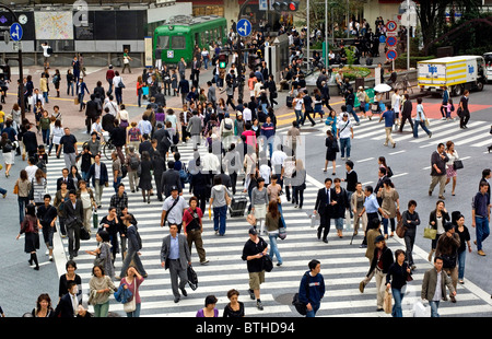 People crossing a street in Shibuya, Tokyo, Japan - Stock Photo