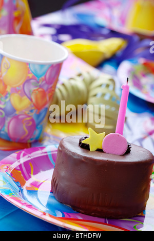 closeup of birthday party table decor and cake - Stock Photo