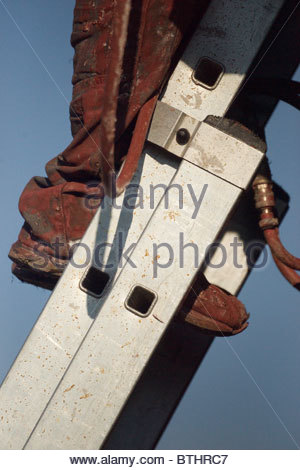 Man on a stepladder - Stock Photo