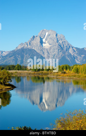 Mount moran reflected perfectly in Ox Bow Bend on the Snake River - Stock Photo