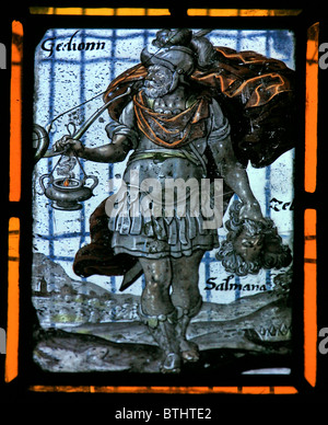 A Stained glass window depicting Gideon with trumpet and clay bottle and torch, Flemish School, circa 17th century - Stock Photo
