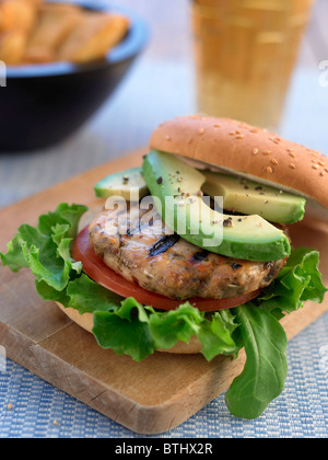 grilled chicken burger in bun - Stock Photo