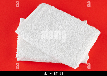 Two flannel white face towels - Stock Photo