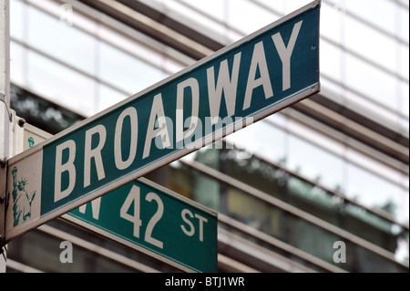 Famous broadway street signs in downtown Manhattan New York - Stock Photo