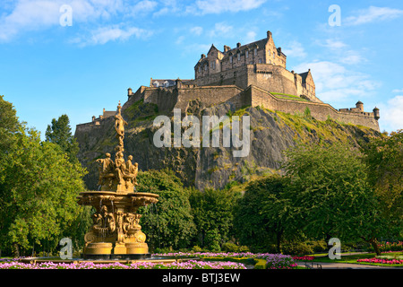 Edinburgh Castle, Scotland, from Princes Street Gardens, with the Ross Fountain in the foreground - Stock Photo