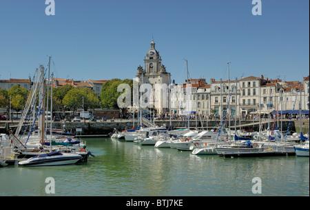 La Rochelle old port harbor with Porte de la Grosse Horloge ( Big Clock Gate) in the background, Charente-Maritime - Stock Photo