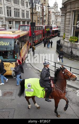 Mounted police in traffic, Whitehall, London, England, United Kingdom - Stock Photo