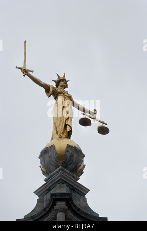 Lady Justice with sword and scales atop Old Bailey (Central Criminal Court ), London, England, United Kingdom - Stock Photo