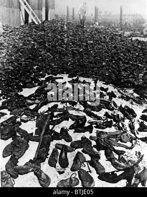 LUBLIN, POLAND--Shoes worn by the millions of men, women and children who marched through the gatess of the annihilation - Stock Photo