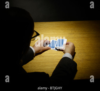 Magician doing a card trick - Stock Photo