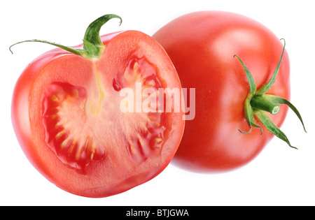 Tomato and half of one. Isolated on a white background. - Stock Photo