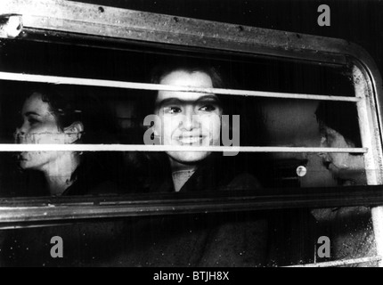 Christine Keeler, with Paula Hamilton-Marshall and Olive Brooker, taken in a police van for a hearing on charges - Stock Photo
