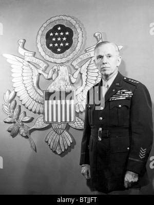 General George C. Marshall standing in front of an enlarged Ofiicers' Insignia, 1943 - Stock Photo