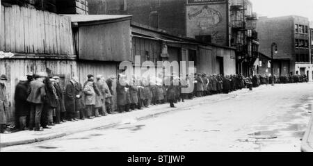 Breadline at McCauley Water Street Mission under Brooklyn Bridge, New York, circa early 1930s. - Stock Photo
